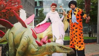 Helter Skelter Flintstones theme stilt walkers