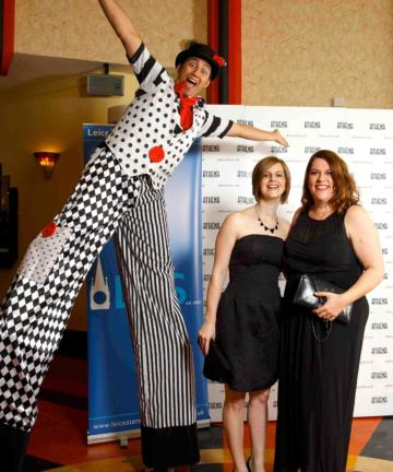 Helter Skelter circus theme stilt walker meet and greet