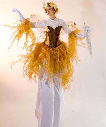 Gold fairy on stilts