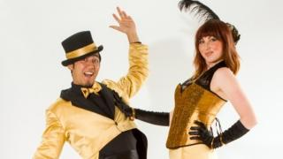 Helter Skelter Gold formal stilt walkers duo