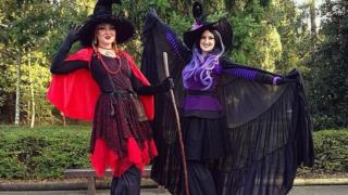 Helter Skelter Theme Halloween Stilt witch duo