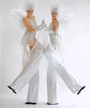 White and silver showgirls 3 on stilts
