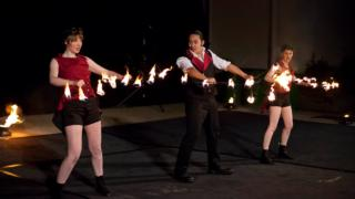 stage show performers do fire dance
